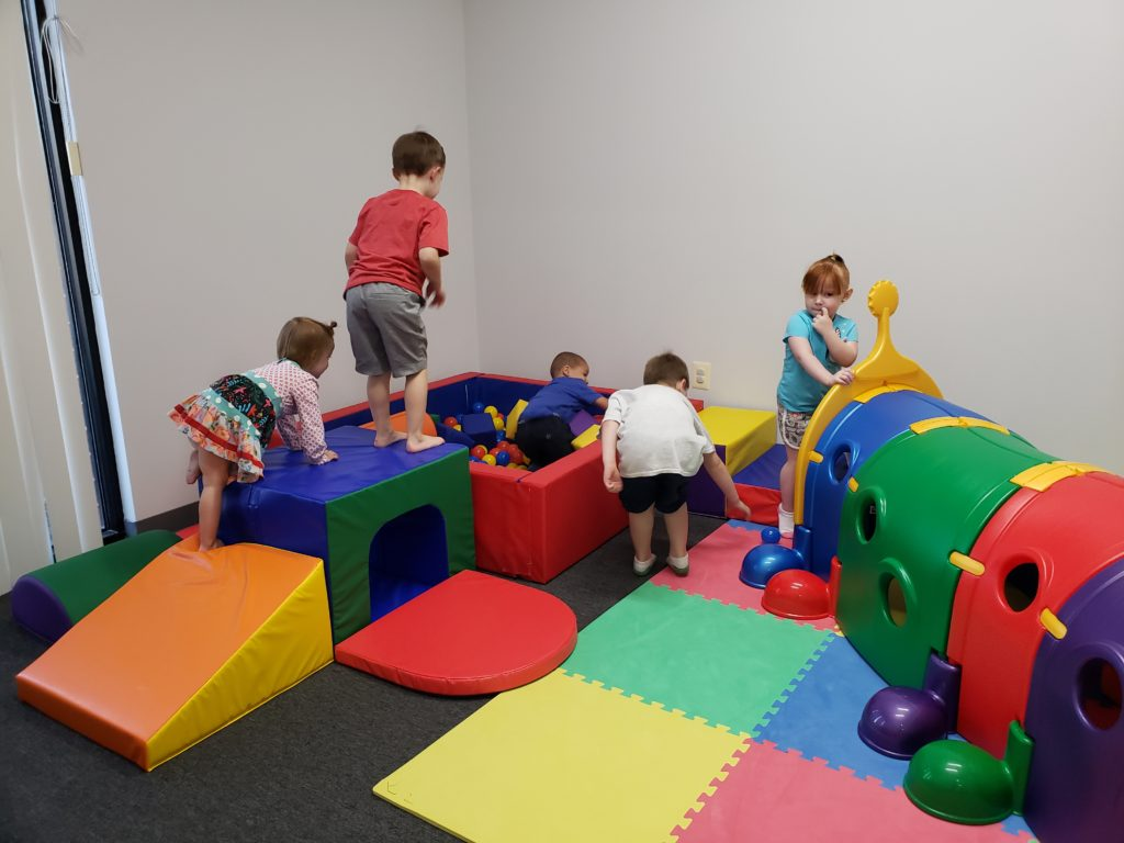 Children playing with gross motor equipment